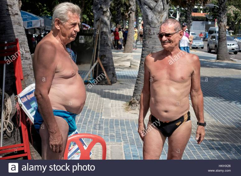 two-mature-men-with-pronounced-stomachs-and-wearing-speedos-swimming-HKHX26.jpg